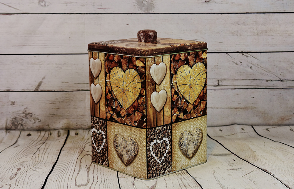 Square-shaped decorative food can with heart shapes on the sides.