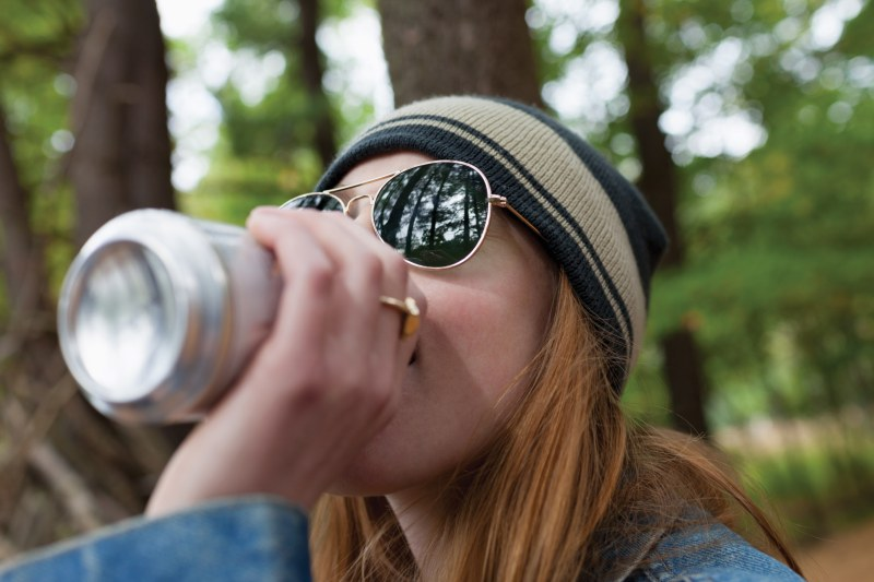 Woman Enjoying a Beverage Outdoors
