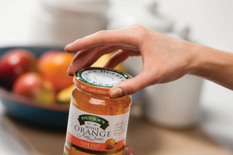 woman opening a can of marmalade