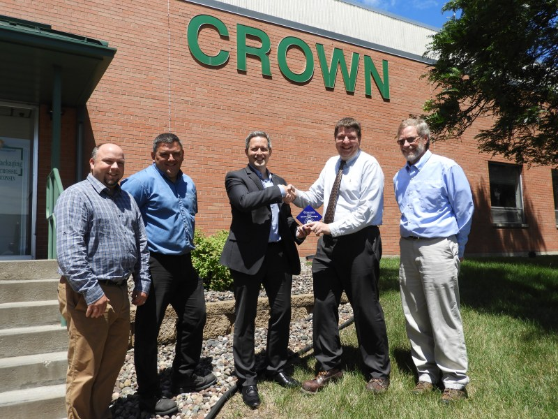 Pictured at the June 21, 2017 awards presentation (left to right) is Alex Lueck, Xcel Energy; Bill  Clements, Crown Beverage Packaging; Chad Bulman, Focus on Energy; Chad Jacobsen,  Crown Beverage Packaging; Randy Urness, Focus on Energy.