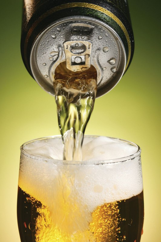 can of beer being poured into a glass