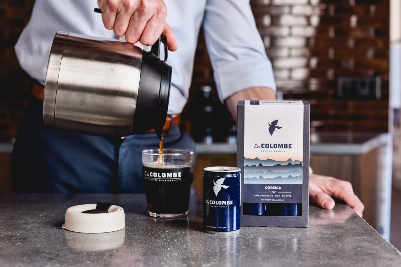 man pours cup of La Colombe coffee