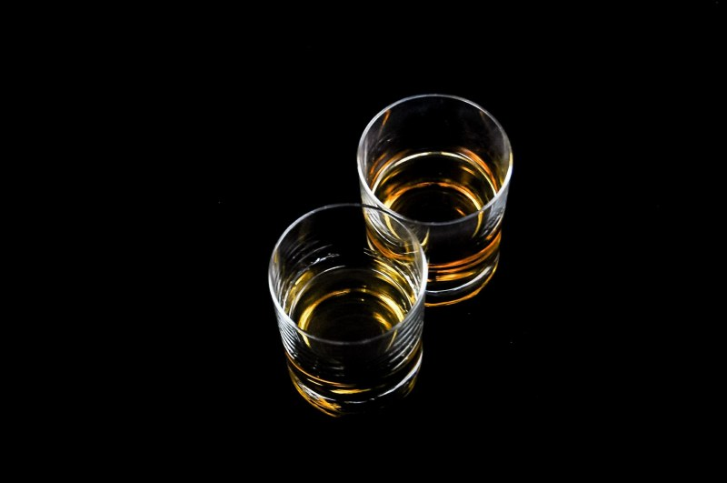 Two classes of scotch with a black background.
