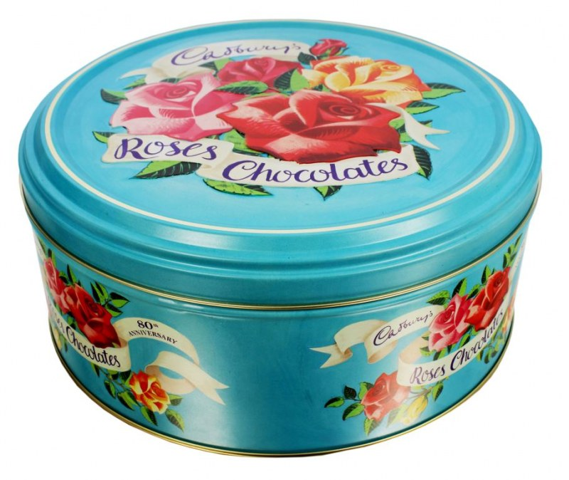 Light blue tin with red, pink, and yellow roses and Cadbury Roses Chocolates written across the top